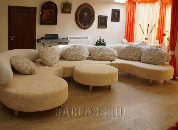 полукруглый диван для гостиной в разложенном виде